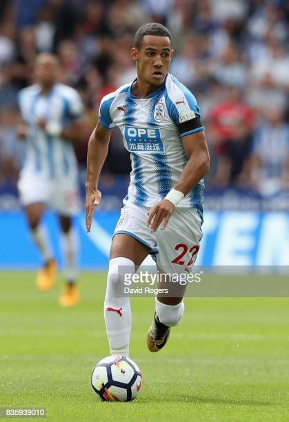Tom Ince of Huddersfield Town runs with the ball during the Premier League match between Huddersfield Town and Newcastle United at John Smith's...