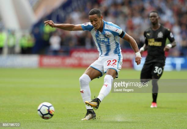 Tom Ince of Huddersfield Town shoots during the Premier League match between Huddersfield Town and Newcastle United at John Smith's Stadium on August...