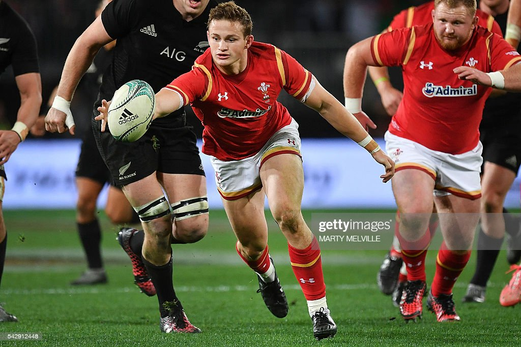 Tom James (C) of Wales gathers the ball as teammate Tomas Francis (R) looks on, during the third rugby union Test match between the New Zealand All Blacks and Wales at Forsyth Barr Stadium in Dunedin on June 25, 2016. / AFP / Marty Melville