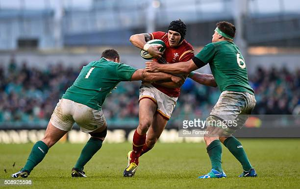 Tom James of Wales is tackled by Jack McGrath and CJ Stander of Ireland during the RBS Six Nations match between Ireland and Wales at the Aviva...