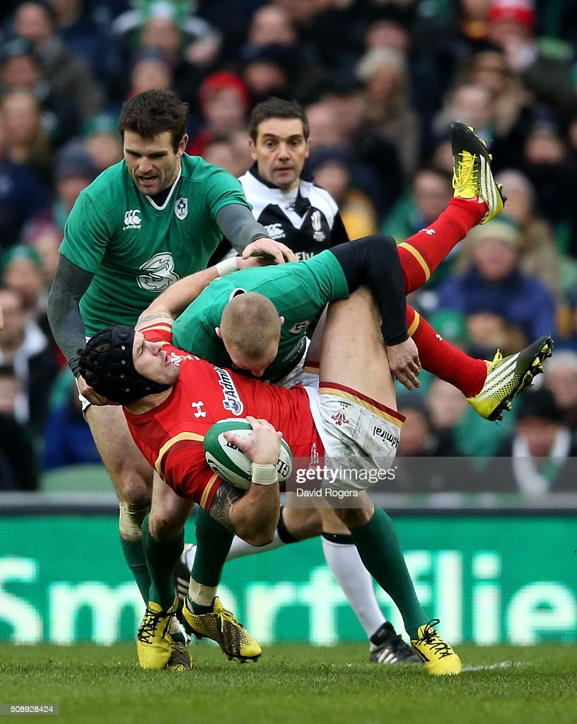 Tom James of Wales is tackled by <a gi-track='captionPersonalityLinkClicked' href=/galleries/search?phrase=Keith+Earls&family=editorial&specificpeople=5409008 ng-click='$event.stopPropagation()'>Keith Earls</a> and <a gi-track='captionPersonalityLinkClicked' href=/galleries/search?phrase=Jared+Payne&family=editorial&specificpeople=835471 ng-click='$event.stopPropagation()'>Jared Payne</a> of Ireland during the RBS Six Nations match between Ireland and Wales at the Aviva Stadium on February 7, 2016 in Dublin, Ireland.