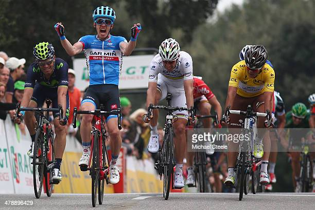 Tom Jelte Slagter of Holland and Garmin Sharp celebrates victory from Rui Costa of Portugal and Lampre Merida and yellow jersey race leader Carlos...
