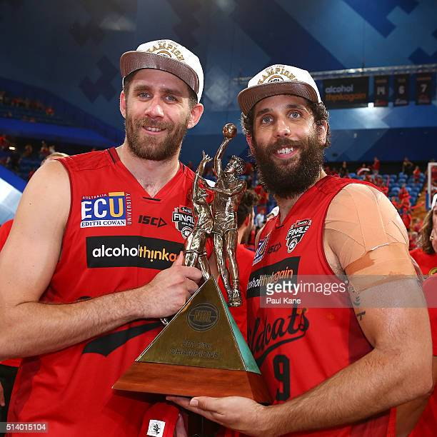 Tom Jervis and Matt Knight of the Wildcats pose with the trophy after winning the Championship during game three of the NBL Grand Final series...