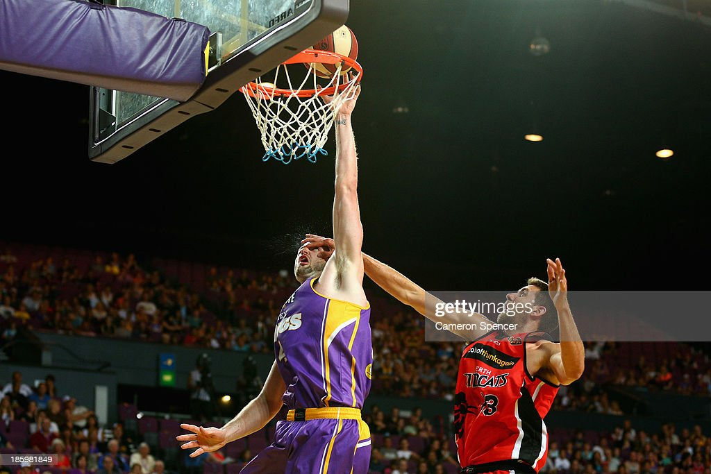 Tom Jervis of the Wildcats attempts to block AJ Ogilvy of the Kings as he drives to the basket during the round three NBL match between the Sydney Kings and the Perth Wildcats at Sydney Entertainment Centre in October 27, 2013 in Sydney, Australia.