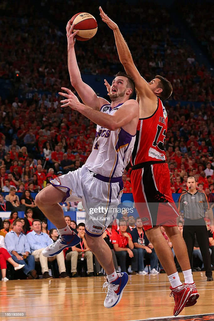 Tom Jervis of the Wildcats blocks Andrew Ogilivy during the round two NBL match between the Perth Wildcats and the Sydney Kings at Perth Arena in October 18, 2013 in Perth, Australia.