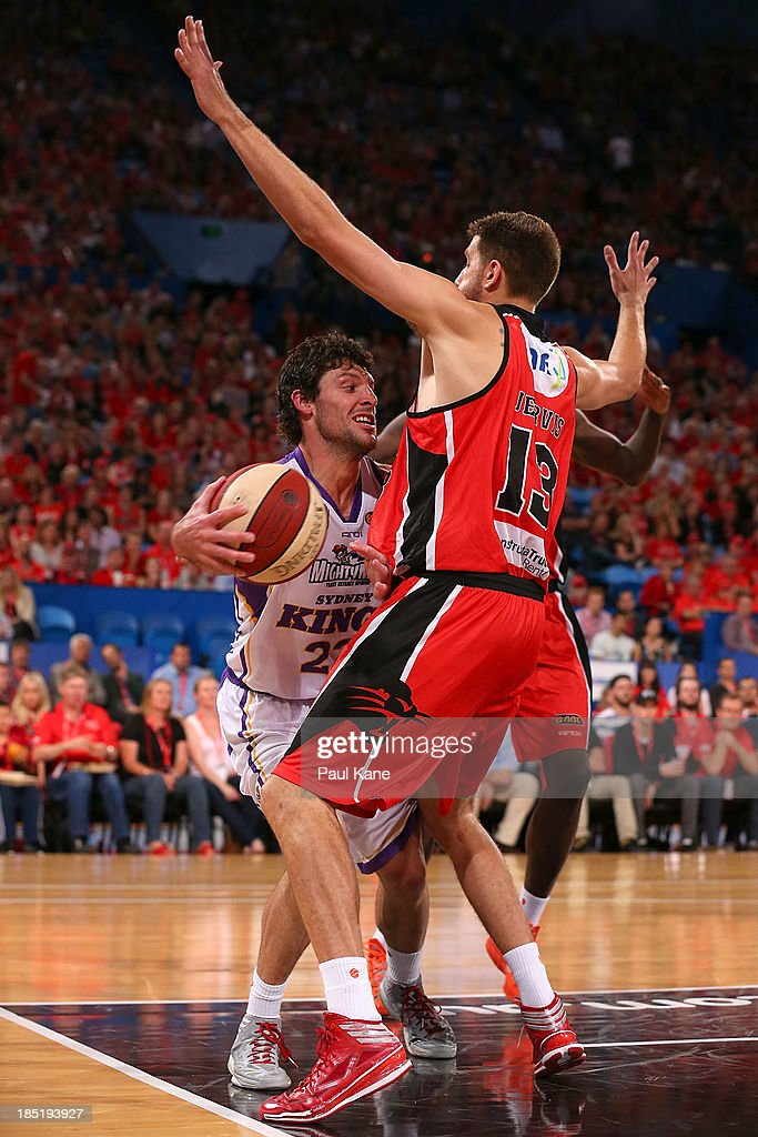 Tom Jervis of the Wildcats blocks Kevin White of the Kings during the round two NBL match between the Perth Wildcats and the Sydney Kings at Perth Arena in October 18, 2013 in Perth, Australia.