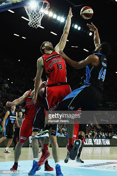 Tom Jervis of the Wildcats defends a shot from Mika Vukona of the Breakers during the round 10 NBL match between the New Zealand Breakers and the...