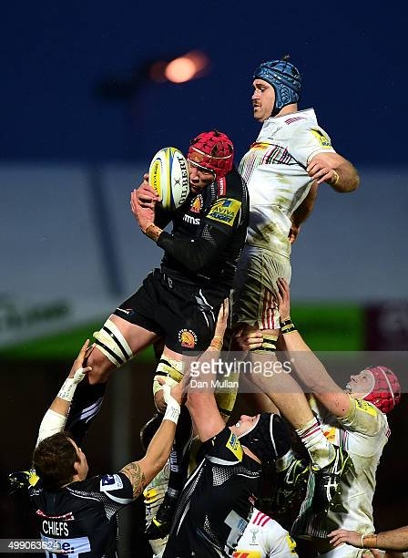 Tom Johnson of Exeter Chiefs claims the line out ahead of James Horwill of Harlequins during the Aviva Premiership match between Exeter Chiefs and...
