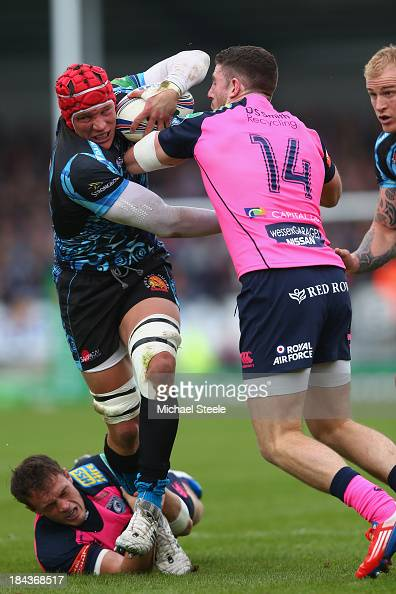 Tom Johnson of Exeter Chiefs forces his way through the challenge of Alex Cuthbert and Cory Allen of Cardiff Blues during the Heineken Cup Pool Two...