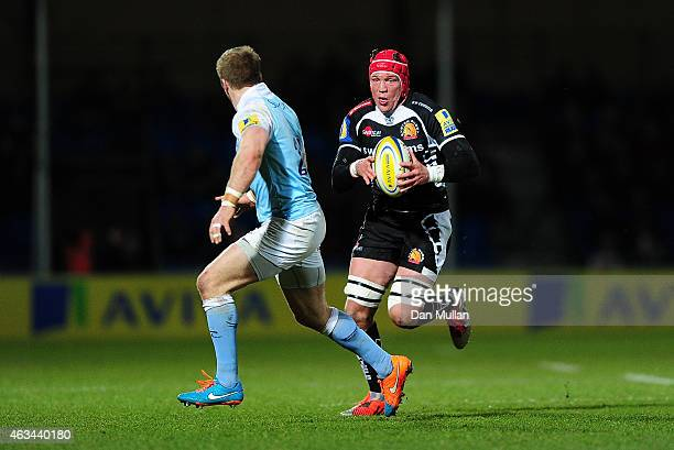 Tom Johnson of Exeter Chiefs takes on Alex Tait of Newcastle Falcons during the Aviva Premiership match between Exeter Chiefs and Newcastle Falcons...