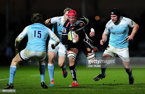 Tom Johnson of Exeter Chiefs takes on Simon Hammersley of Newcastle Falcons during the Aviva Premiership match between Exeter Chiefs and Newcastle...
