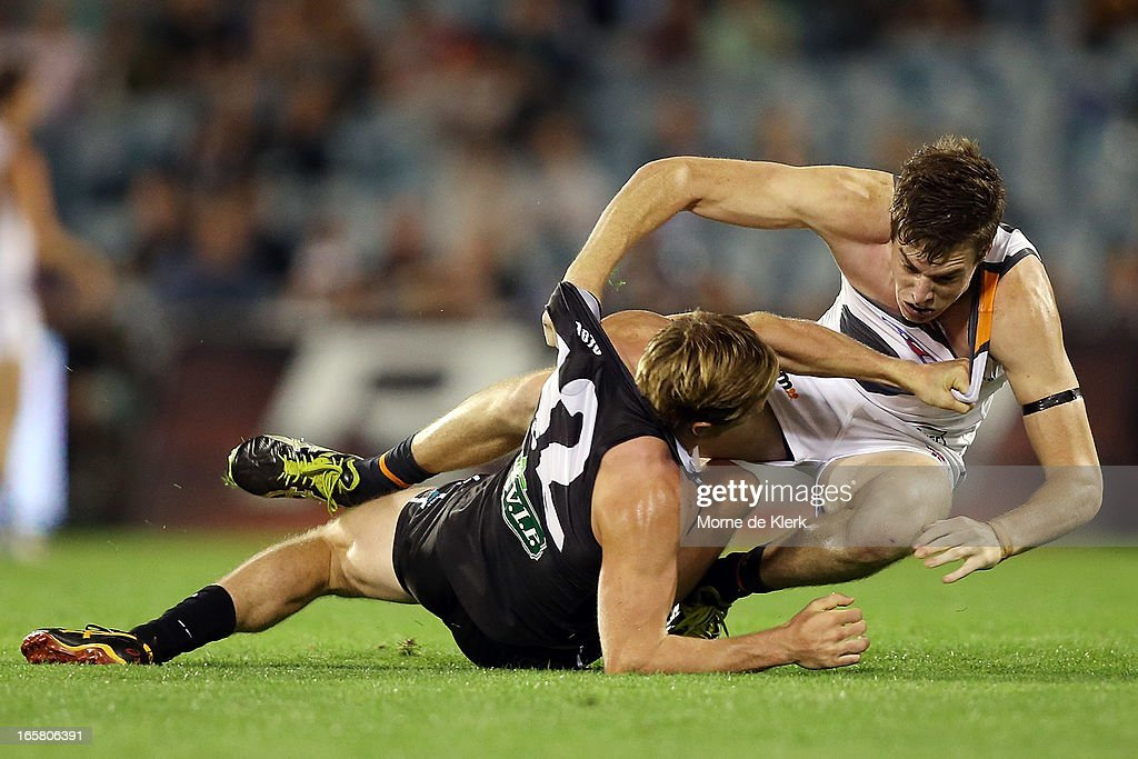 Tom Jonas of the Power and Jeremy Cameron of the Giants take each other down in a scuffle during the round two AFL match between Port Adelaide Power and the Greater Western Sydney Giants at AAMI Stadium on April 6, 2013 in Adelaide, Australia.