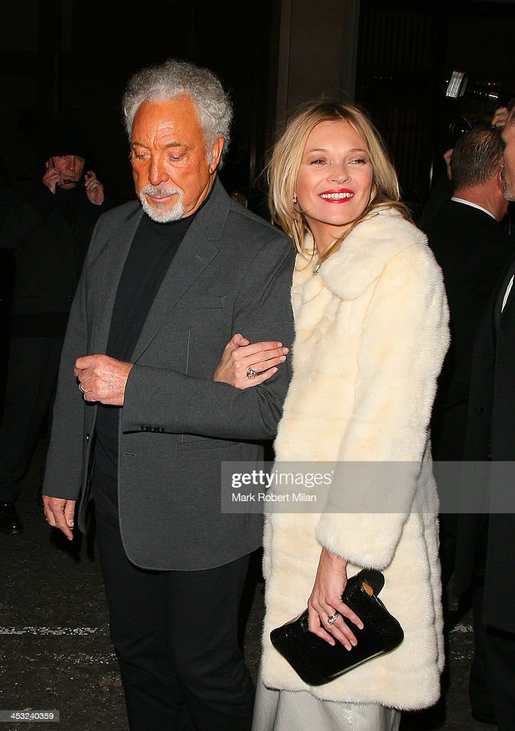 Tom Jones and <a gi-track='captionPersonalityLinkClicked' href=/galleries/search?phrase=Kate+Moss&family=editorial&specificpeople=201830 ng-click='$event.stopPropagation()'>Kate Moss</a> at the Playboy club on December 2, 2013 in London, England.