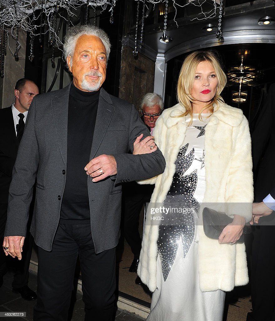 Tom Jones and <a gi-track='captionPersonalityLinkClicked' href=/galleries/search?phrase=Kate+Moss&family=editorial&specificpeople=201830 ng-click='$event.stopPropagation()'>Kate Moss</a> leave Claridge's Hotel before heading to the Playboy Member's Club in Mayfair on December 2, 2013 in London, England.