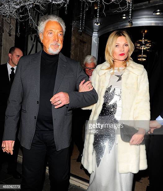 Tom Jones and Kate Moss leave Claridge's Hotel before heading to the Playboy Member's Club in Mayfair on December 2 2013 in London England
