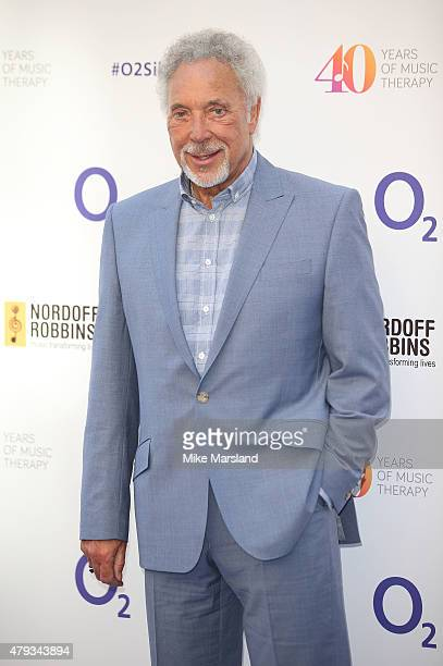 Tom Jones arrives at the Nordoff Robbins O2 Silver Clef Awards at The Grosvenor House Hotel on July 3 2015 in London England