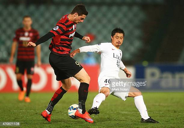 Tom Juric of the Wanderers and Mitsuo Ogasawara of Kashima contest possession during the Asian Champions League match between the Western Sydney...