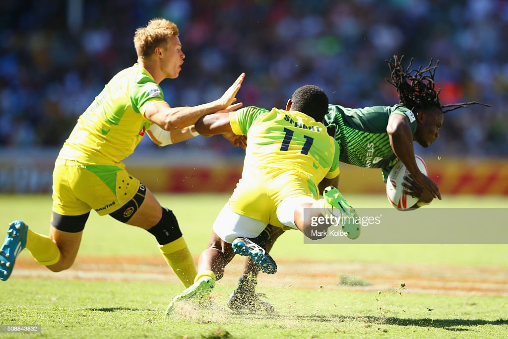 Tom Kingston and <a gi-track='captionPersonalityLinkClicked' href=/galleries/search?phrase=Henry+Speight&family=editorial&specificpeople=4388674 ng-click='$event.stopPropagation()'>Henry Speight</a> of Australia tackle Rosko Specman of South Africa during the 2016 Sydney Sevens cup semi final match between Australia and South Africa at Allianz Stadium on February 7, 2016 in Sydney, Australia.