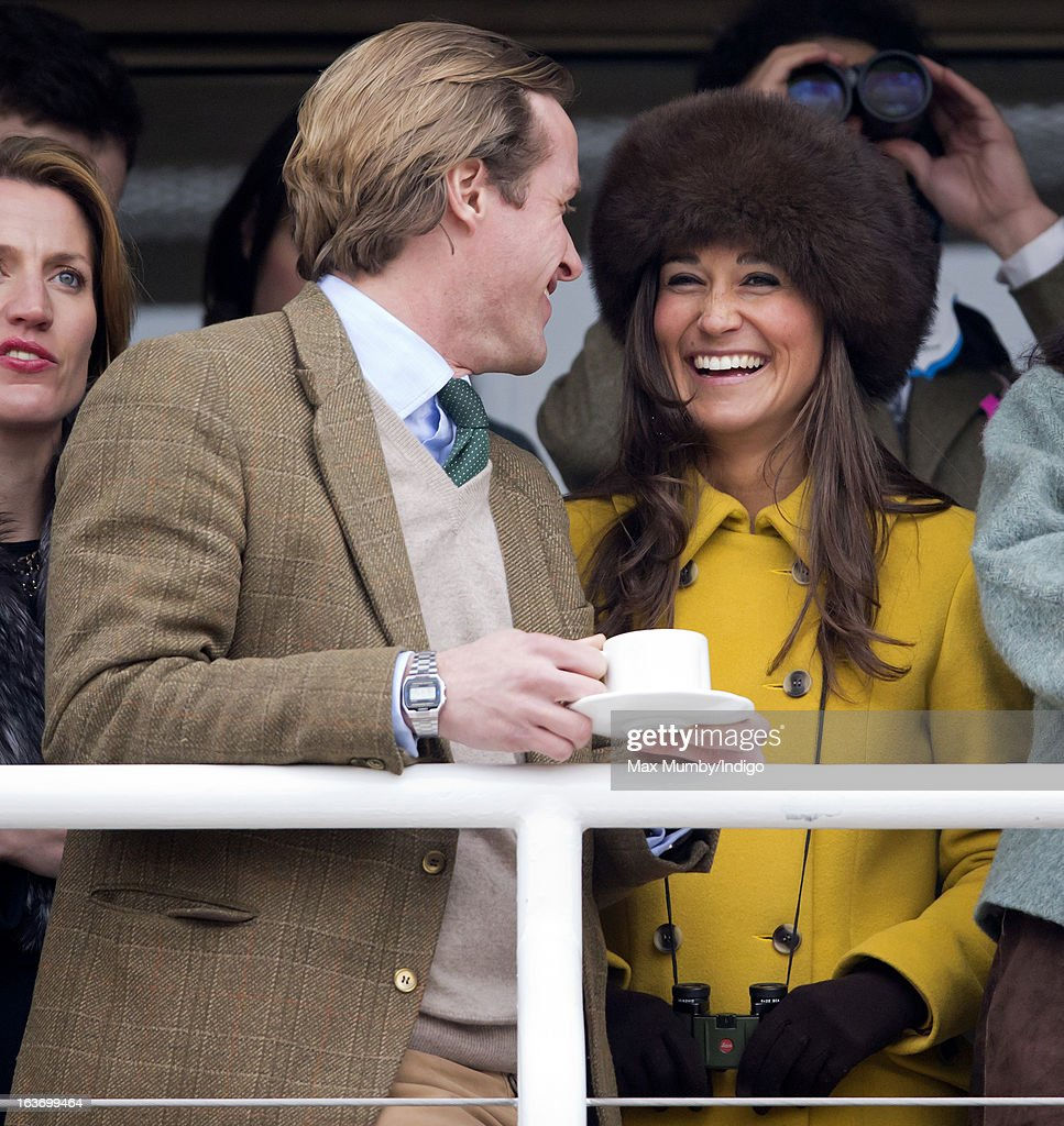 Tom Kingston and Pippa Middleton watch the racing as they attend Day 3 of The Cheltenham Festival at Cheltenham Racecourse on March 14, 2013 in London, England.