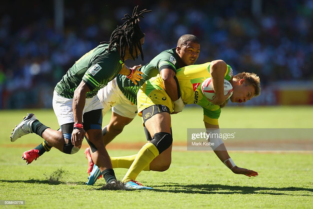 Tom Kingston of Australia is tackled high by Juan de Jongh of South Africa during the 2016 Sydney Sevens cup semi final match between Australia and South Africa at Allianz Stadium on February 7, 2016 in Sydney, Australia.