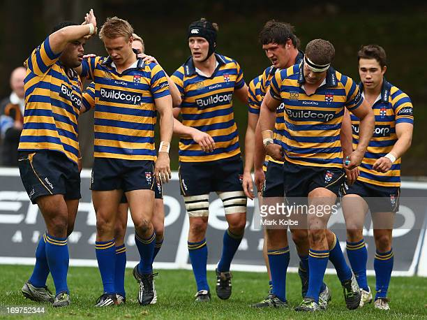 Tom Kingston of Sydney University is congratulated by his team mates after scoring a try during the round nine Shute Shield match between Sydney...