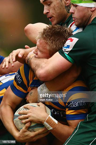 Tom Kingston of Sydney University is tackled during the round nine Shute Shield match between Sydney University and Randwick at University Oval No 1...