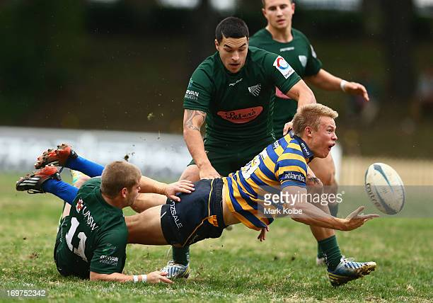 Tom Kingston of Sydney University passes as he is tackled during the round nine Shute Shield match between Sydney University and Randwick at...