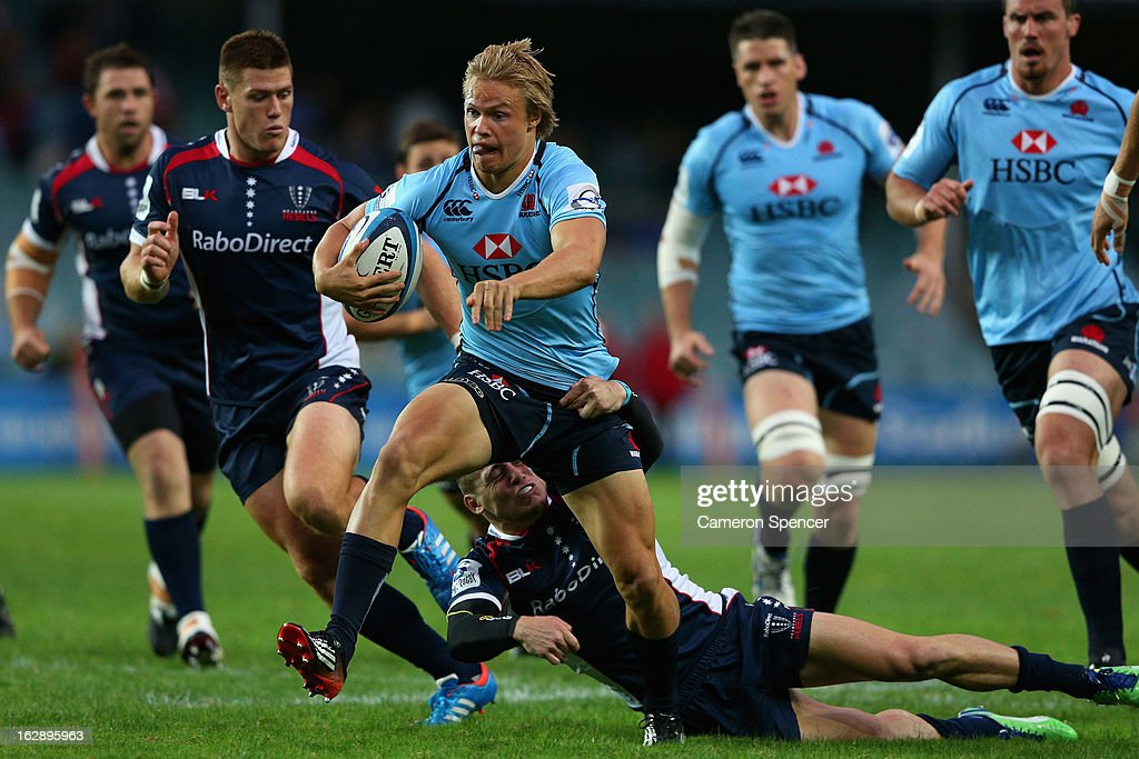 Tom Kingston of the Waratahs is tackled during the round three Super Rugby match between the Waratahs and the Rebels at Allianz Stadium on March 1, 2013 in Sydney, Australia.