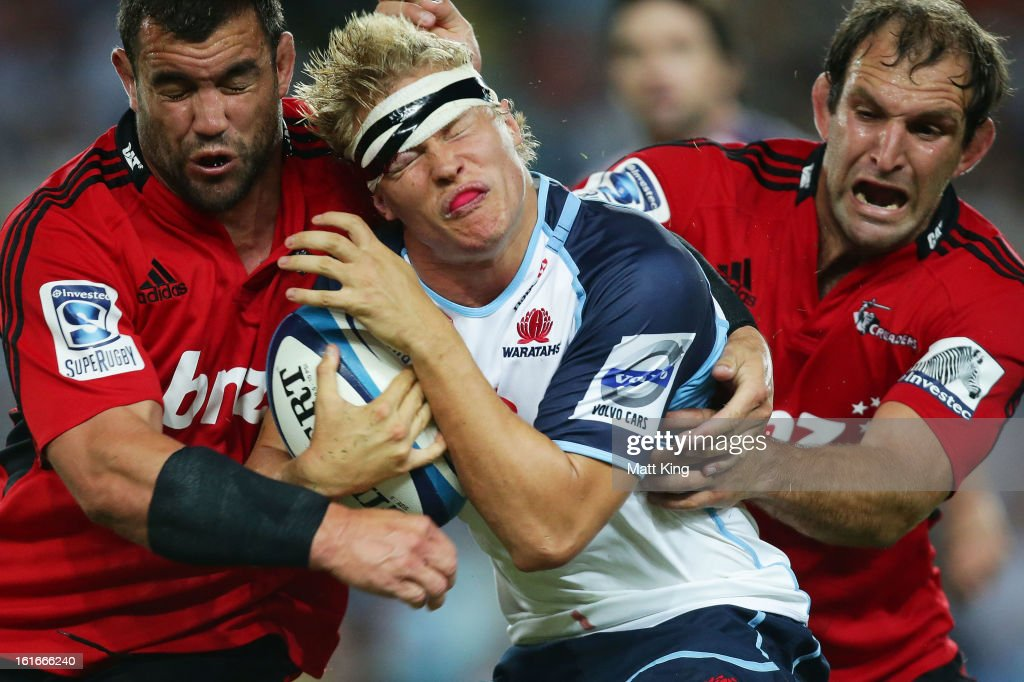 Tom Kingston of the Waratahs is tackled during the Super Rugby trial match between the Waratahs and the Crusaders at Allianz Stadium on February 14, 2013 in Sydney, Australia.