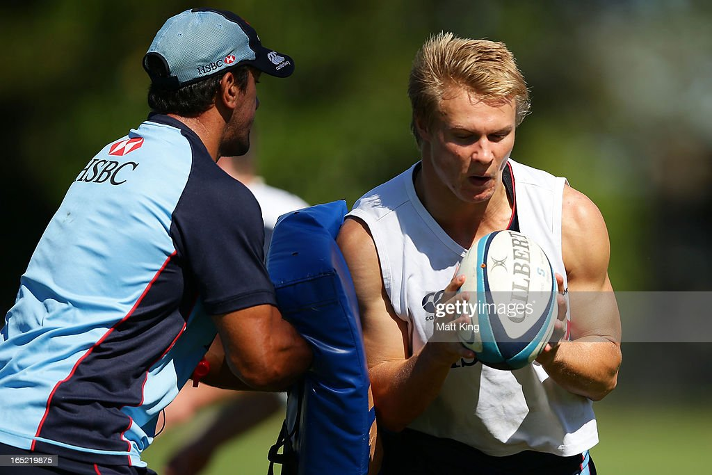 Tom Kingston runs with the ball during a Waratahs Super Rugby training session at Moore Park on April 2, 2013 in Sydney, Australia.