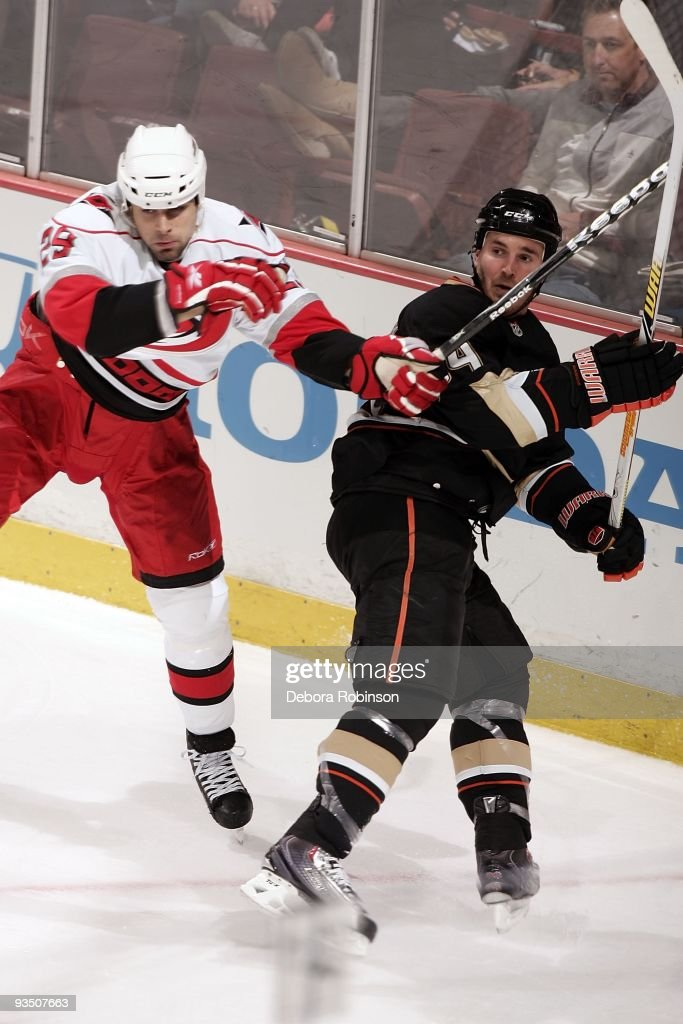 Tom Kostopoulos of the Carolina Hurricanes collides with James Wisniewski of the Anaheim Ducks during the game on November 25 2009 at Honda Center in...