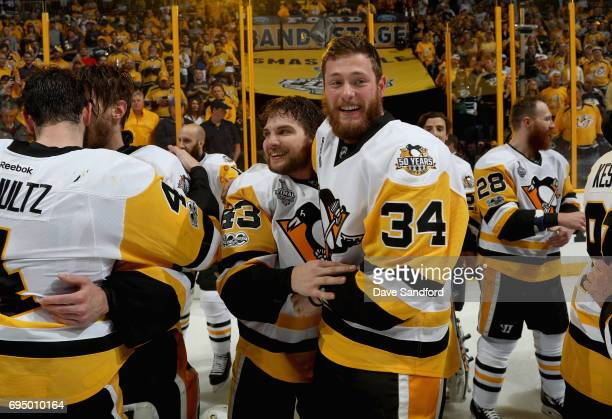 Tom Kuhnhackl and Conor Sheary of the Pittsburgh Penguins celebrate after the Penguins defeated the Nashville Predators 20 to win the 2017 NHL...