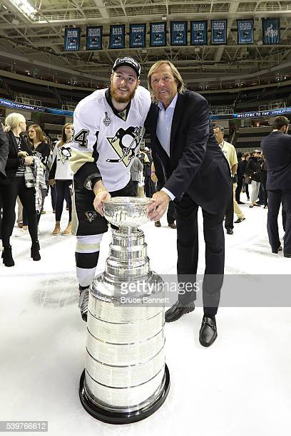 Tom Kuhnhackl of the Pittsburgh Penguins and his father Erich celebrate with the Stanley Cup after their 31 victory to win the Stanley Cup against...