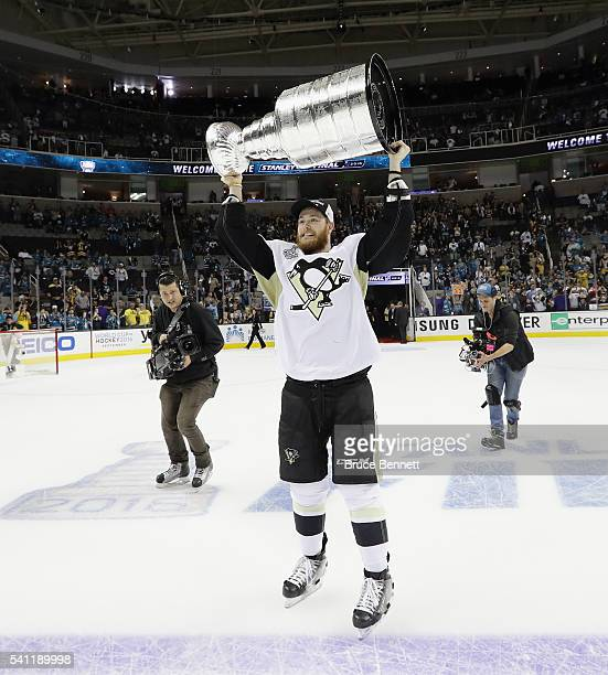 Tom Kuhnhackl of the Pittsburgh Penguins carries the Stanley Cup following victory over the San Jose Sharks in Game Six of the 2016 NHL Stanley Cup...