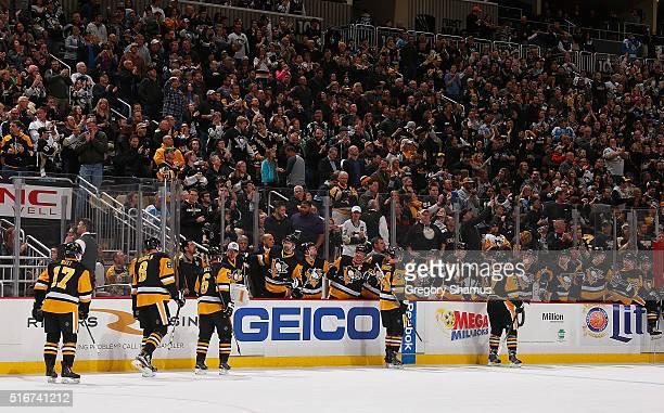 Tom Kuhnhackl of the Pittsburgh Penguins celebrates his goal with the bench during the second period against the Washington Capitals at Consol Energy...