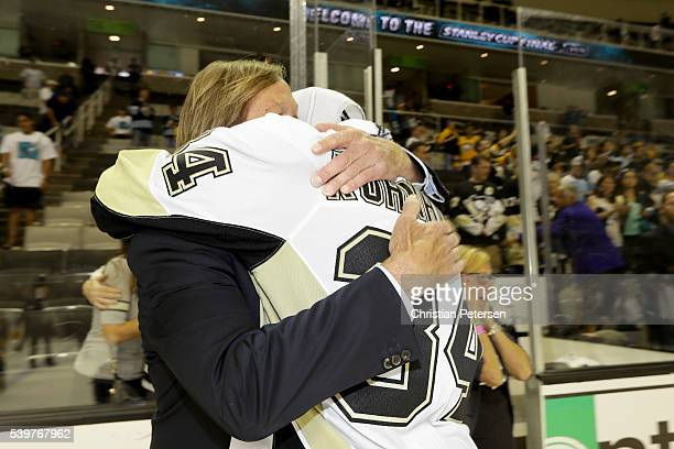 Tom Kuhnhackl of the Pittsburgh Penguins celebrates with his father Erich after their 31 victory to win the Stanley Cup against the San Jose Sharks...