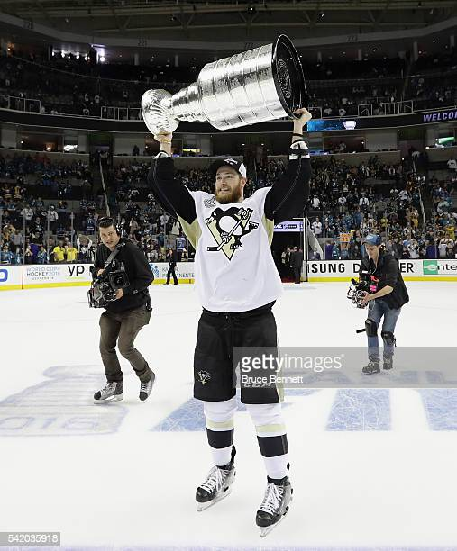 Tom Kuhnhackl of the Pittsburgh Penguins celebrates with the Stanley Cup after their 31 victory to win the Stanley Cup against the San Jose Sharks in...