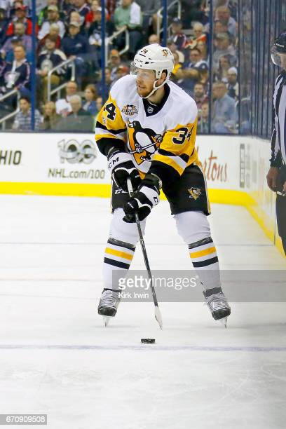 Tom Kuhnhackl of the Pittsburgh Penguins controls the puck in Game Four of the Eastern Conference First Round during the 2017 NHL Stanley Cup...