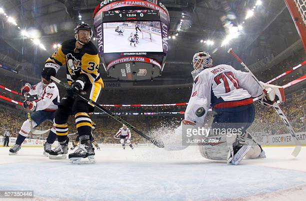 Tom Kuhnhackl of the Pittsburgh Penguins scores past Braden Holtby of the Washington Capitals in the first period in Game Three of the Eastern...