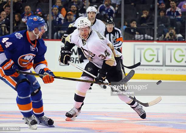 Tom Kuhnhackl of the Pittsburgh Penguins skates against the New York Islanders at the Barclays Center on April 2 2016 in the Brooklyn borough of New...