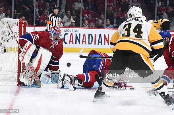 Tom Kuhnhackl of the Pittsburgh Penguins takes a shot on goal Al Montoya of the Montreal Canadiens in the NHL game at the Bell Centre on October 18...