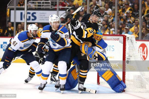 Tom Kuhnhackl of the Pittsburgh Penguins tries to find the puck between Jake Allen and Paul Stastny of the St Louis Blues during the second period at...