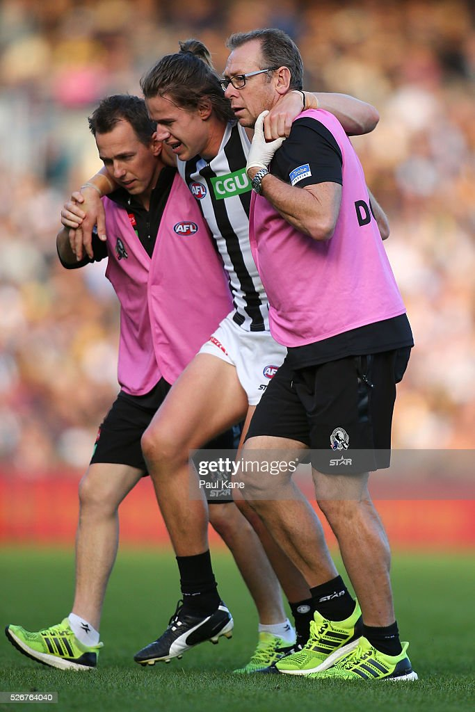Tom Langdon of the Magpies is assisted from the field with an injury during the round six AFL match between the West Coast Eagles and the Collingwood Magpies at Domain Stadium on May 1, 2016 in Perth, Australia.