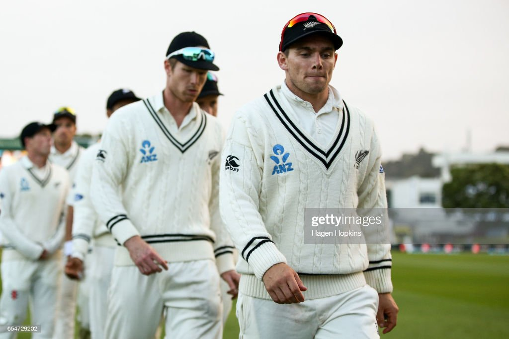Tom Latham and Jimmy Neesham of New Zealand leave the field after the loss during day three of the test match between New Zealand and South Africa at Basin Reserve on March 18, 2017 in Wellington, New Zealand.