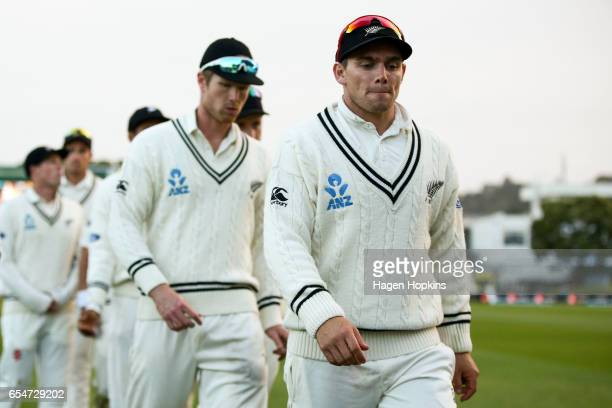 Tom Latham and Jimmy Neesham of New Zealand leave the field after the loss during day three of the test match between New Zealand and South Africa at...