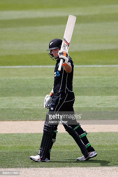 Tom Latham of New Zealand celebrates after reaching a half century during the first One Day International match between New Zealand and Bangladesh at...