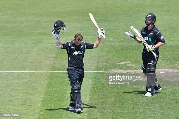 Tom Latham of New Zealand celebrates his century during the first One Day International match between New Zealand and Bangladesh at Hagley Oval on...