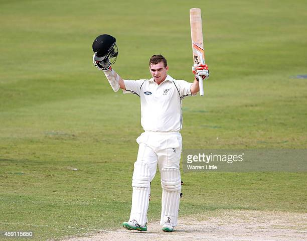 Tom Latham of New Zealand celebrates reaching his century during day one of the second test between Pakistan and New Zealand at Dubai International...