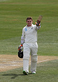 Tom Latham of New Zealand celebrates scoring 100 runs during day four of the First Test match between New Zealand and Sri Lanka at University Oval on...