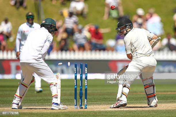 Tom Latham of New Zealand is bowled out by Mehidy Hassan Miraz of Bangladesh while Sabbir Rahman looks on during day five of the First Test match...
